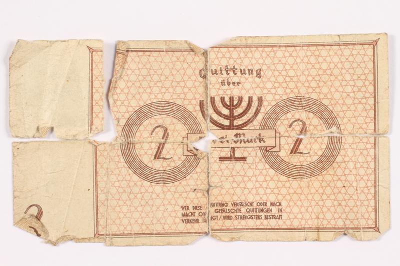 2003.460.2 front Łódź ghetto scrip, 2 mark note, in 3 pieces acquired by Polish Jewish survivor