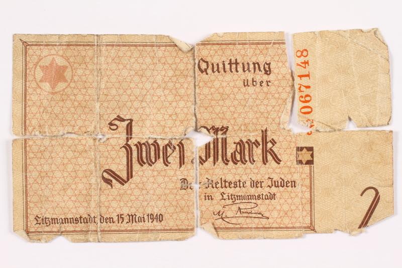 2003.460.2 back Łódź ghetto scrip, 2 mark note, in 3 pieces acquired by Polish Jewish survivor