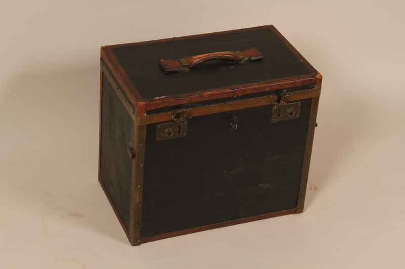 2004.322.2 front Small square black painted wooden trunk used by Jewish refugees