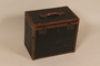Small square black painted wooden trunk used by Jewish refugees