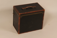 2004.322.2 back Small square black painted wooden trunk used by Jewish refugees  Click to enlarge