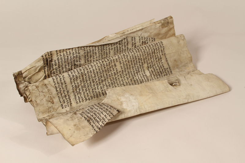 1991.227.1 a front Desecrated Torah scroll recovered postwar by a Polish Jew