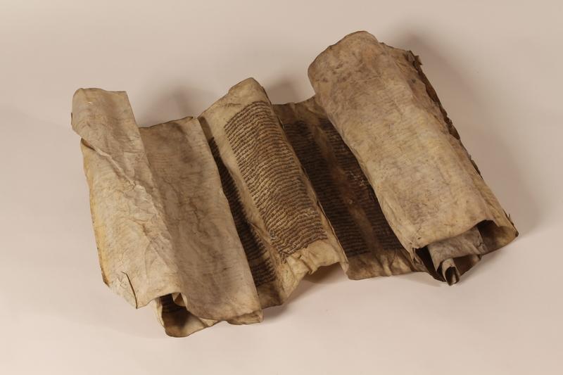 1991.227.1 e open Desecrated Torah scroll recovered postwar by a Polish Jew