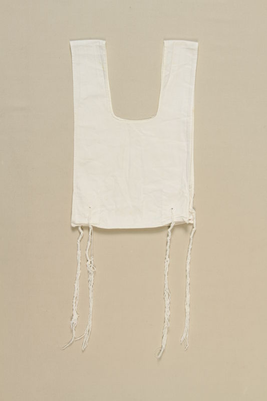 2004.406.3 front White cotton tallit katan used by a Polish Jewish elder