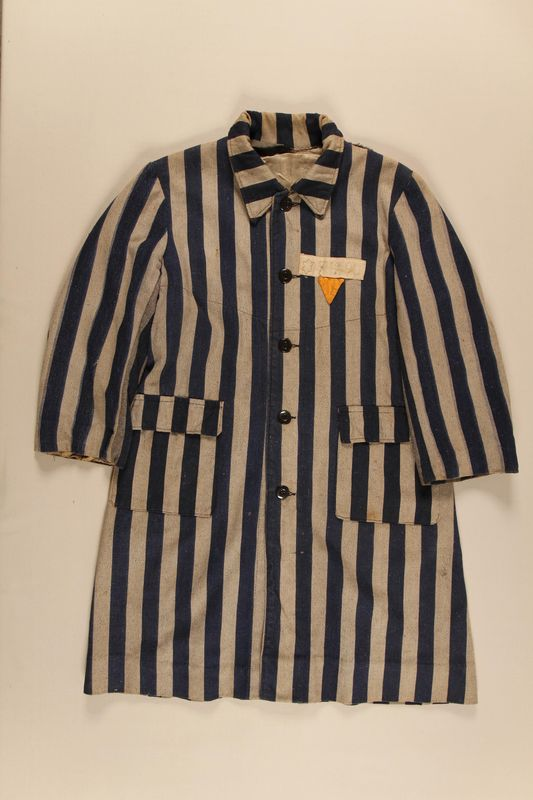 2004.411.1 front Concentration camp striped uniform coat with yellow triangle worn by a Polish Jewish female inmate