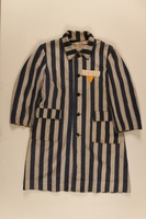 2004.411.1 front Concentration camp striped uniform coat with yellow triangle worn by a Polish Jewish female inmate  Click to enlarge