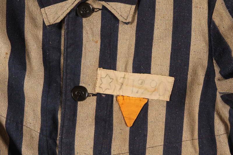 2004.411.1 detail Concentration camp striped uniform coat with yellow triangle worn by a Polish Jewish female inmate