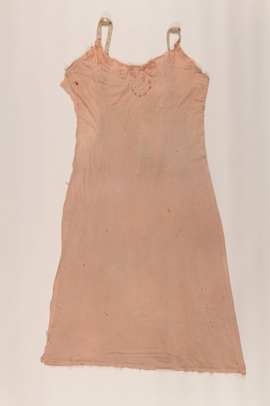 2004.437.2 front Embroidered pink slip worn while in hiding in Poland