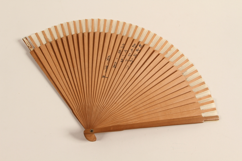 2003.464.2 front Folding Fan owned by a Japanese aid coordinator for Jewish refugees in Shanghai