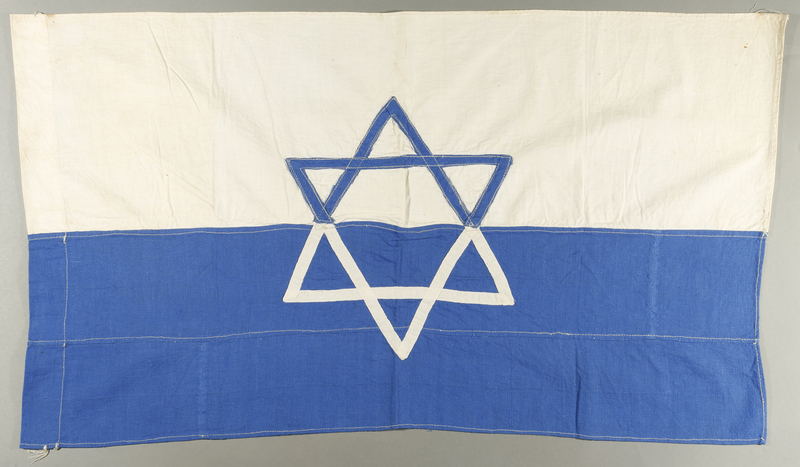 1998.147.1 front Handmade white flag with a blue Star of David made by a German refugee in Shanghai