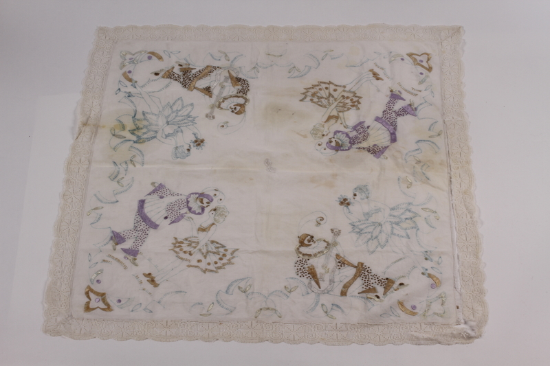 2005.606.1 front Partially embroidered tablecloth made by a Belgian Jewish woman recovered postwar