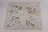 2005.606.1 front Partially embroidered tablecloth made by a Belgian Jewish woman recovered postwar  Click to enlarge