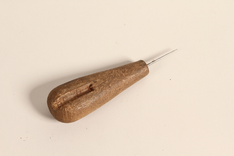 2004.523.20 front Stitching awl with a 1.25 inch needle used by a Polish Jewish refugee conscripted as a shoemaker by the Soviet Army