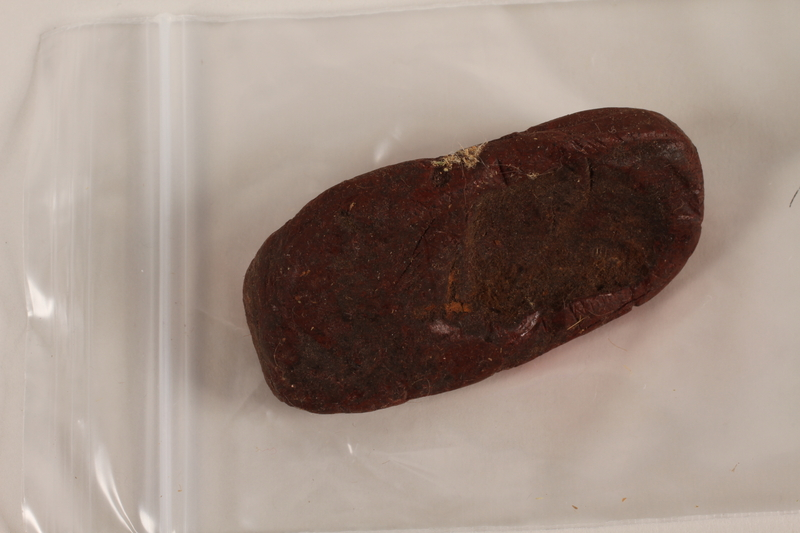 2004.523.24 front Dark red shoe wax used by a Polish Jewish refugee conscripted as a shoemaker by the Soviet Army
