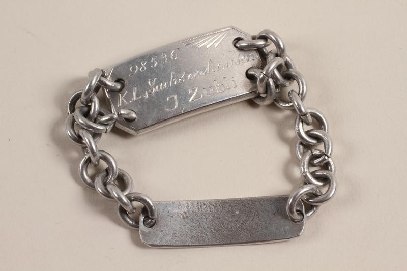 2004.554.2 front Prisoner ID bracelet worn by a non-Jewish doctor imprisoned for resistance activity