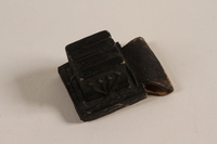 2004.576.1 a front Pair of batim from a set of tefillin rescued after Kristallnacht and recovered postwar  Click to enlarge