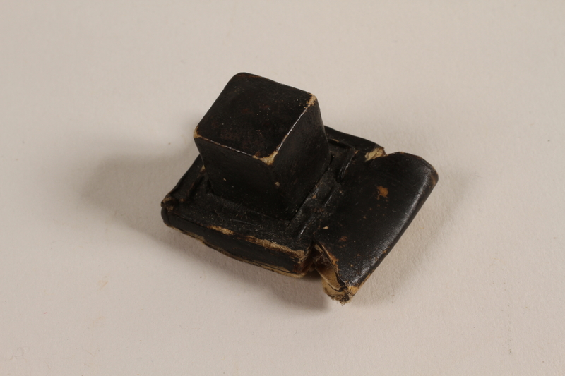 2004.576.1 b front Pair of batim from a set of tefillin rescued after Kristallnacht and recovered postwar