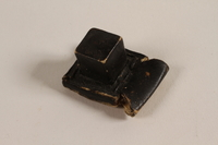 2004.576.1 b front Pair of batim from a set of tefillin rescued after Kristallnacht and recovered postwar  Click to enlarge