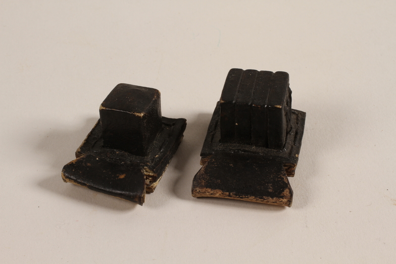 2004.576.1 a-b front Pair of batim from a set of tefillin rescued after Kristallnacht and recovered postwar