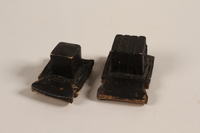 2004.576.1 a-b front Pair of batim from a set of tefillin rescued after Kristallnacht and recovered postwar  Click to enlarge