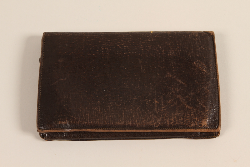 2004.577.2 front Leather wallet with 6 pockets used by a German Jewish refugee to hold wartime documents