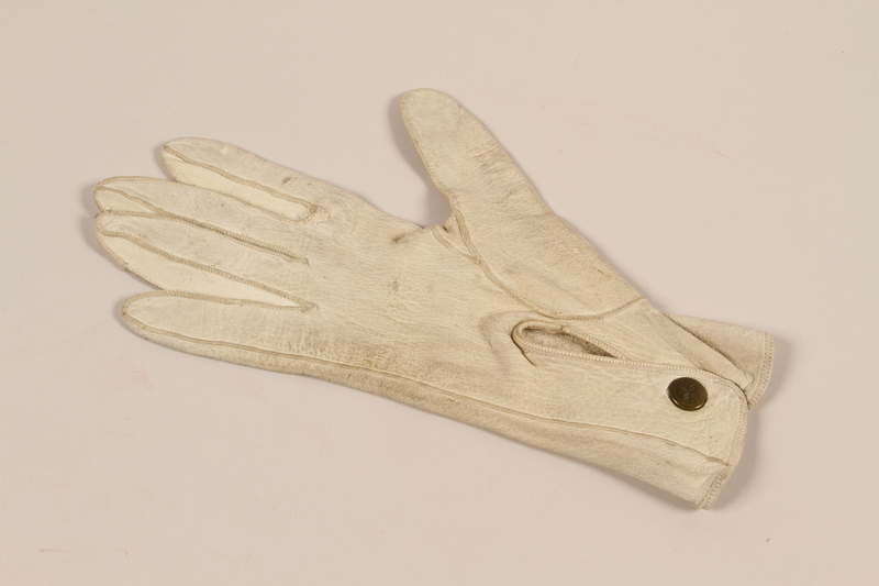 2004.628.3_a front Pair of men's white leather driving gloves carried by a Jewish refugee during his escape from Vienna