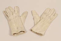 2004.628.3_a-b front Pair of men's white leather driving gloves carried by a Jewish refugee during his escape from Vienna  Click to enlarge