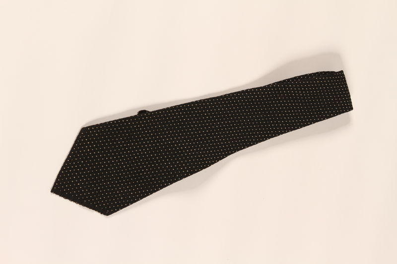 2004.628.4 front Black patterned silk necktie owned by a Jewish refugee