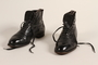 Pair of men's black leather lace-up ankle boots owned by a Jewish refugee during his escape from Vienna