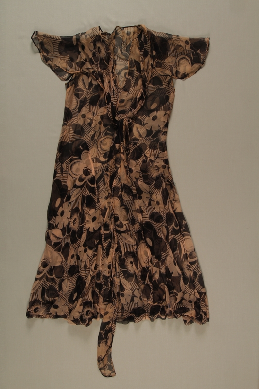 2004.628.6 front Pink and black floral patterned chiffon dress owned by a Jewish refugee from Austria