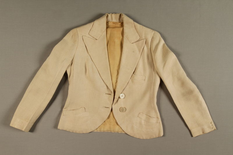 2004.628.7 front Woman's white cloth tailored jacket owned by a Jewish refugee during her escape from Vienna