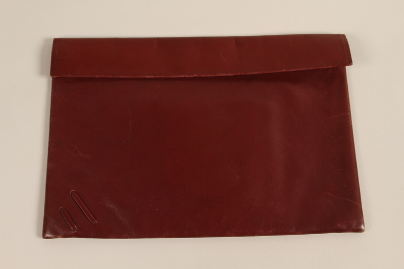 2004.628.8 front Red leather purse with decorative lacing carried by a Jewish refugee during her escape from Vienna