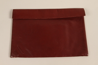 2004.628.8 front Red leather purse with decorative lacing carried by a Jewish refugee during her escape from Vienna  Click to enlarge