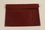 Red leather purse with decorative lacing carried by a Jewish refugee during her escape from Vienna