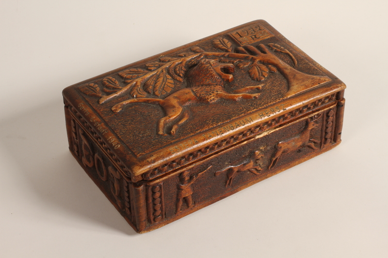 2004.630.3 closed Carved wooden box handmade and used in the Lodz Ghetto