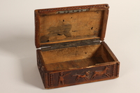 2004.630.3 open Carved wooden box handmade and used in the Lodz Ghetto  Click to enlarge
