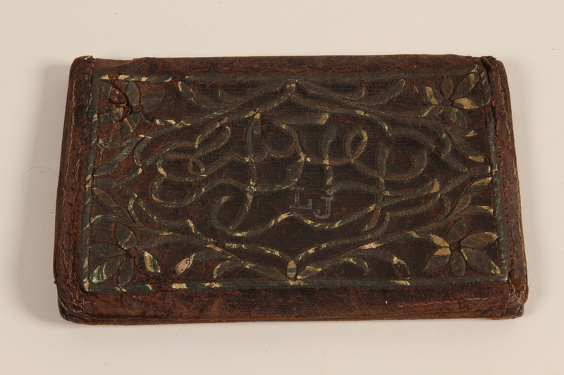 2004.630.5 front Brown leather wallet with inlaid floral decorations handcrafted and used in the Łódź Ghetto