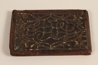 2004.630.5 front Brown leather wallet with inlaid floral decorations handcrafted and used in the Łódź Ghetto  Click to enlarge