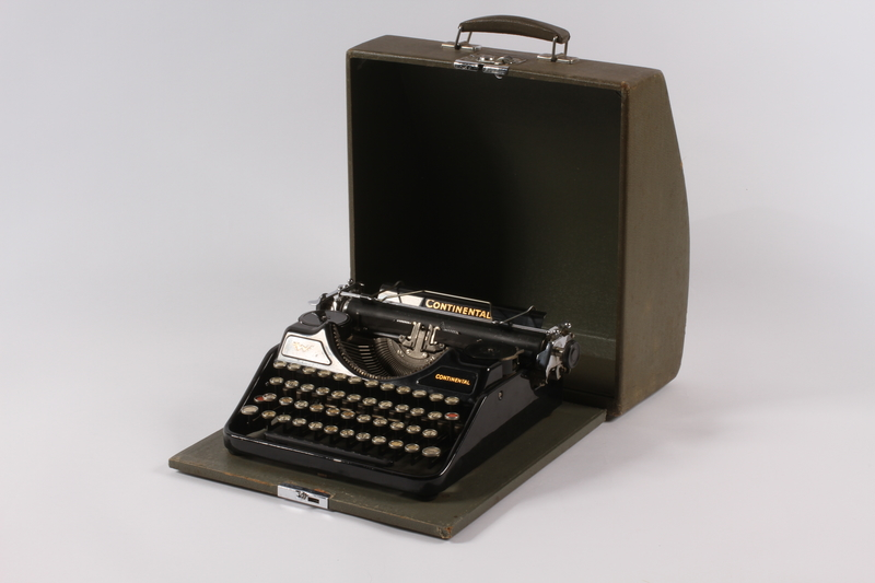 2004.661.1 a-b open Continental typewriter with a green wooden cover used by Martin Niemoeller