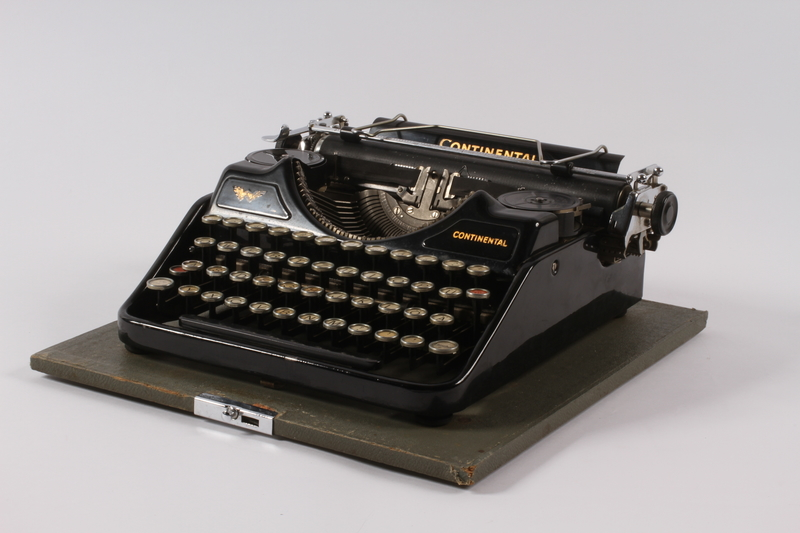 2004.661.1 a front Continental typewriter with a green wooden cover used by Martin Niemoeller