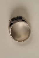 2005.96.1 side Signet ring with an engraving of the Łódź ghetto bridge owned by a ghetto resident  Click to enlarge