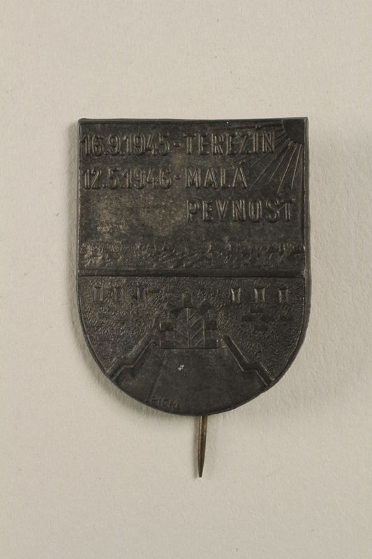 2004.692.6 front 1st Anniversary commemorative pin for the victims of Theresienstadt acquired by a Czech Jewish survivor