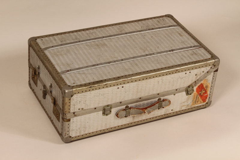 2005.140.4 front Embossed aluminum flat top steamer trunk used by a German Jewish refugee