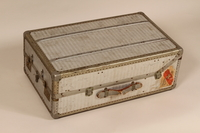 2005.140.4 front Embossed aluminum flat top steamer trunk used by a German Jewish refugee  Click to enlarge