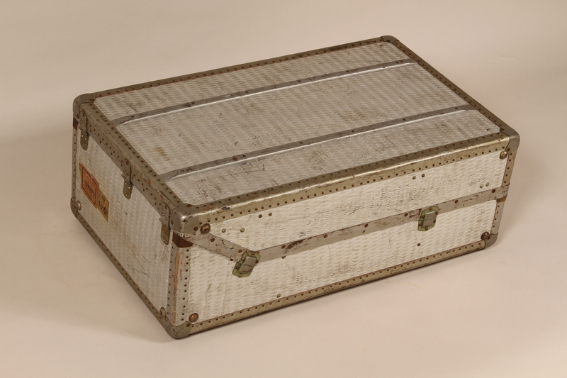2005.140.4 back Embossed aluminum flat top steamer trunk used by a German Jewish refugee
