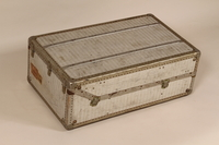 2005.140.4 back Embossed aluminum flat top steamer trunk used by a German Jewish refugee  Click to enlarge