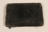 2003.318.2 front Black leather bi-fold wallet used by a Jewish family in hiding  Click to enlarge