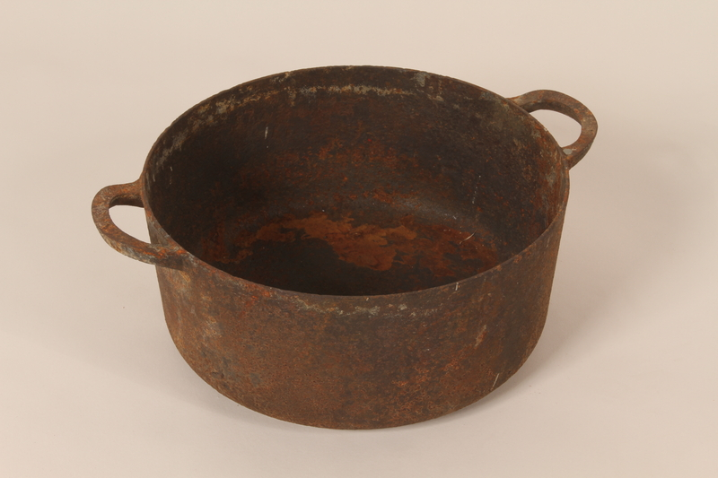 2005.174.5 front Cast iron dutch oven pot from cafe used as rendezvous point by French resistance