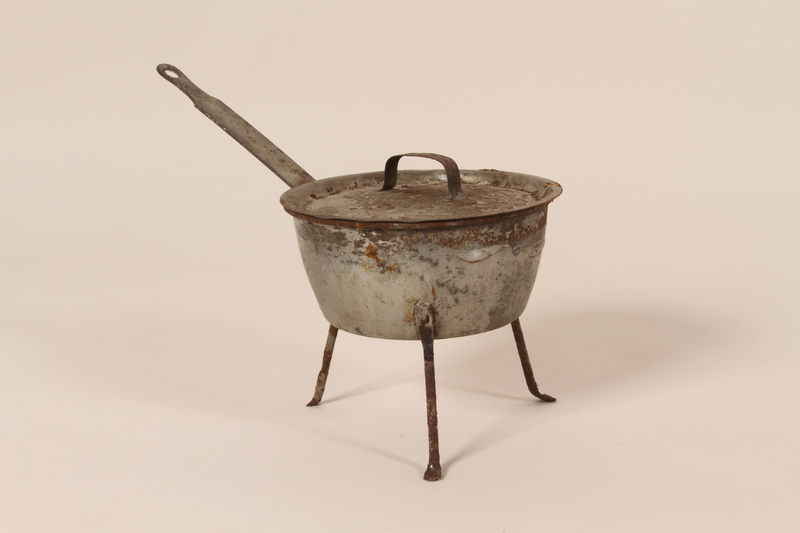 2005.174.6 a-b closed Aluminum tripod sauce pot with lid from cafe used as rendezvous point by French resistance