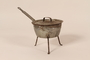 Aluminum tripod sauce pot with lid from cafe used as rendezvous point by French resistance